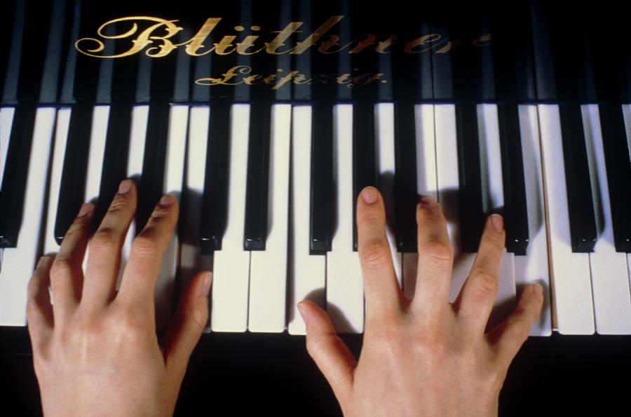 Playing The Piano. Photograph