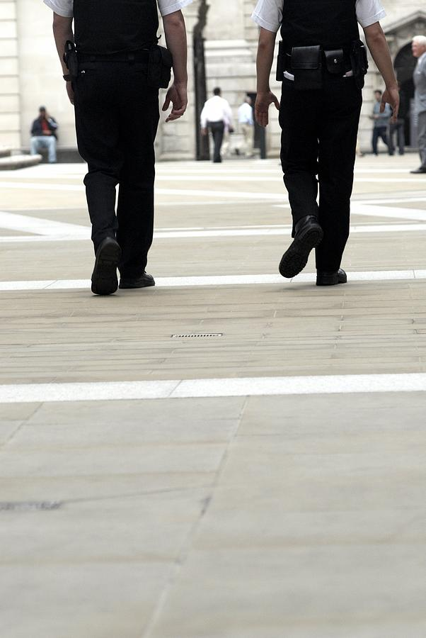 Human Photograph - Police Officers Patrolling by Tony Mcconnell