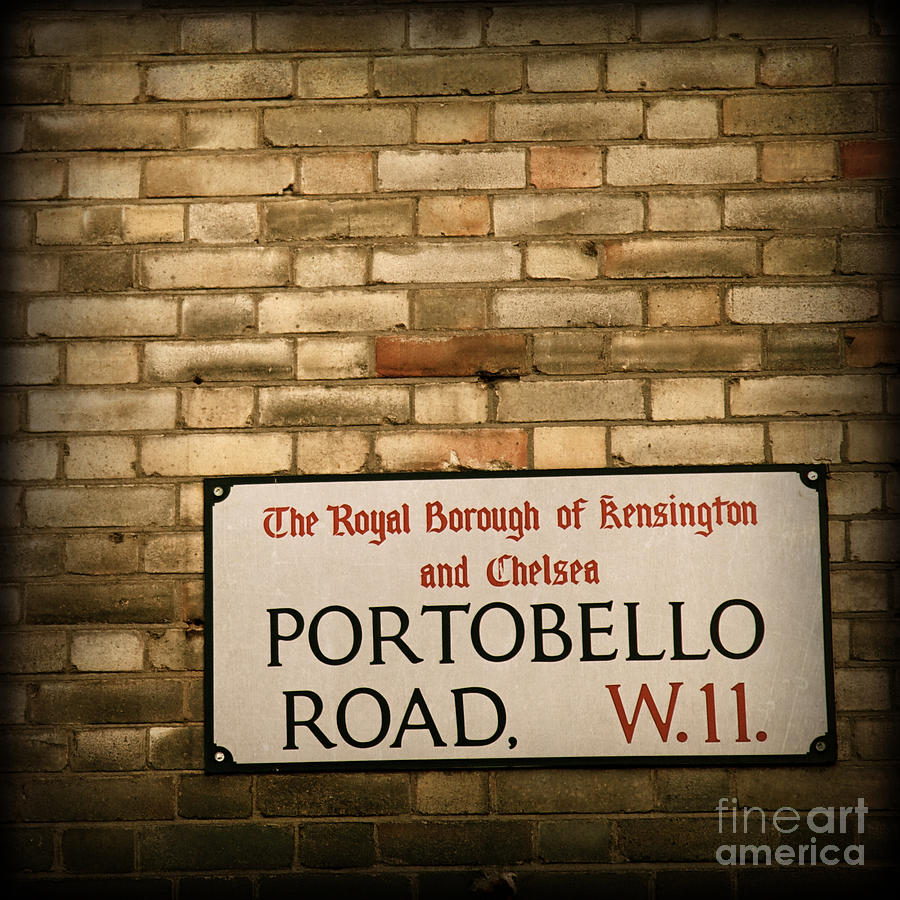 Portobello Road Sign On A Grunge Brick Wall In London England Photograph  - Portobello Road Sign On A Grunge Brick Wall In London England Fine Art Print