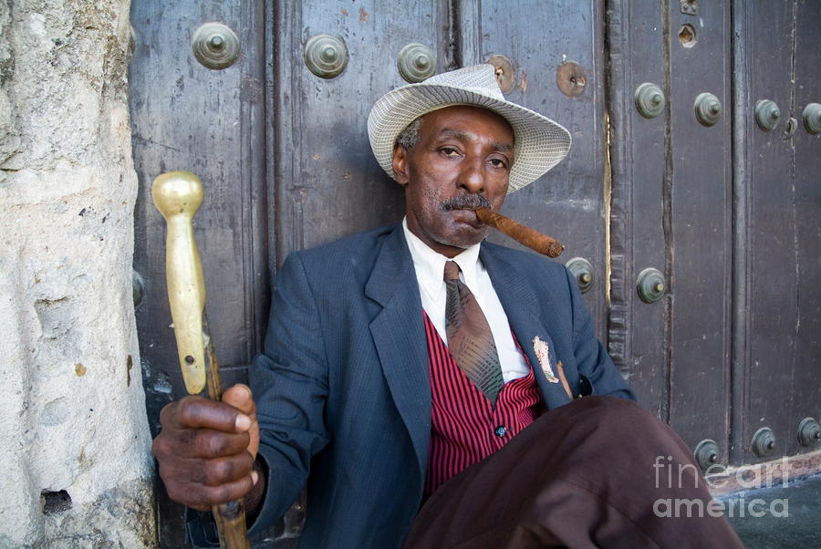 Portrait Of A Man Wearing A 1930s-style Suit And Smoking A Cigar In Havana Photograph  - Portrait Of A Man Wearing A 1930s-style Suit And Smoking A Cigar In Havana Fine Art Print