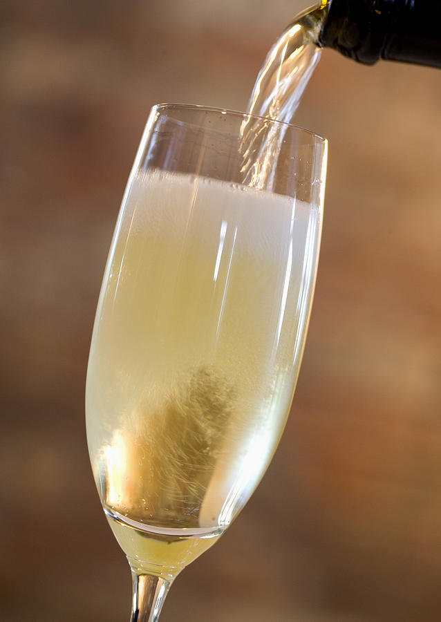 Pouring Champagne Photograph