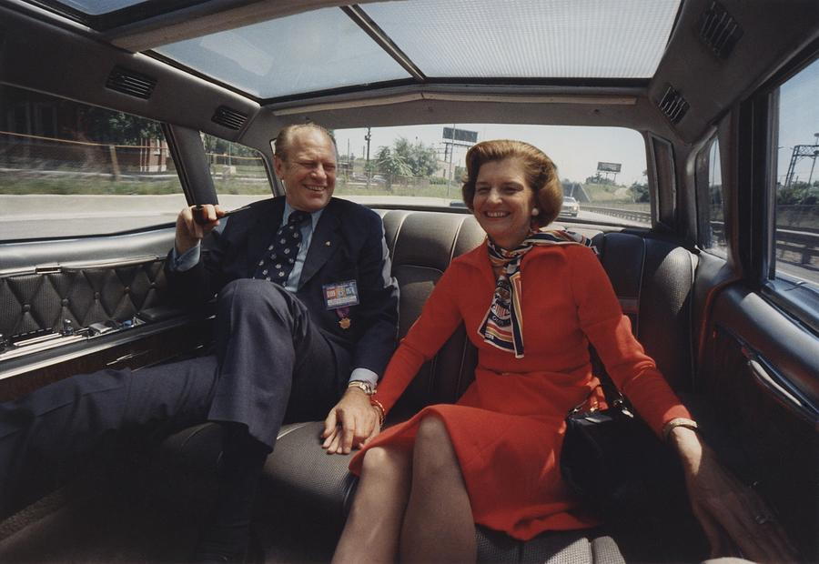 History Photograph - President And Betty Ford Hold Hands by Everett