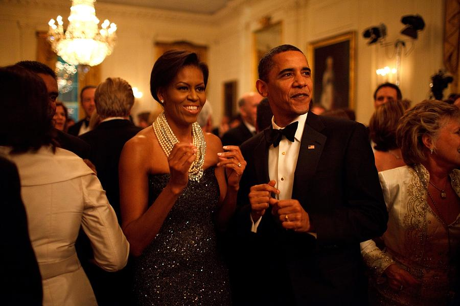 President And Michelle Obama Applaud Photograph