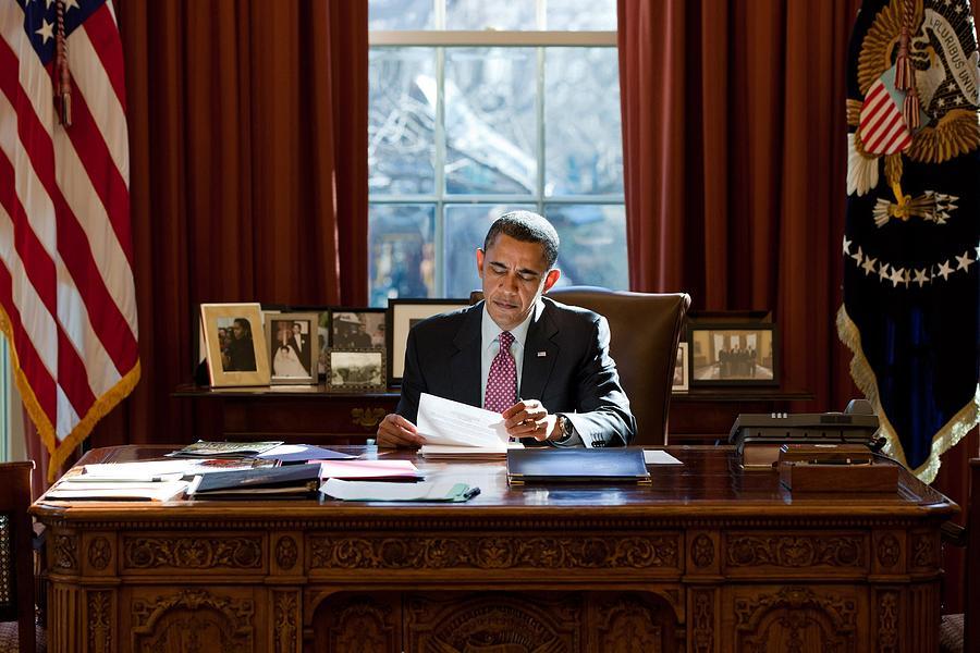 President Barack Obama Reviews Photograph