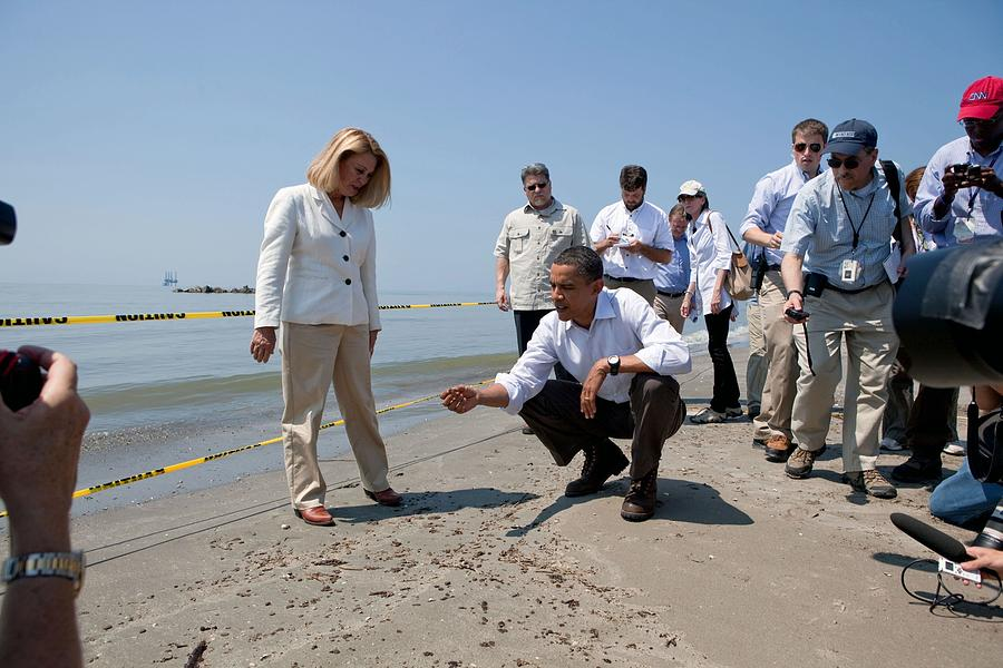 President Obama Inspects A Tar Ball Photograph