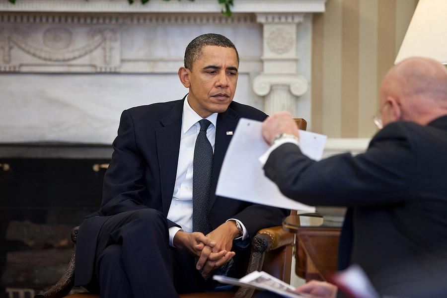 President Obama Studies A Document Held Photograph