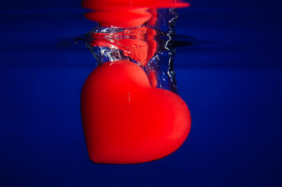 Red Heart Into Blue Water Photograph by Riaan Roux
