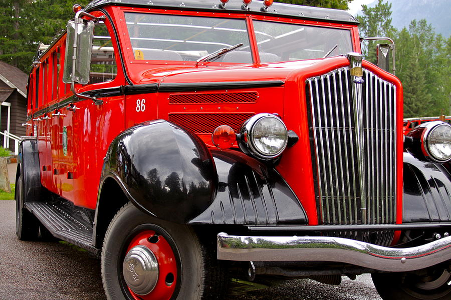 Red Photograph - Red Jammer Tour Bus Glacier National Park by Karon Melillo DeVega
