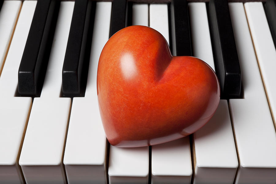 Red Stone Heart On Piano Keys Photograph