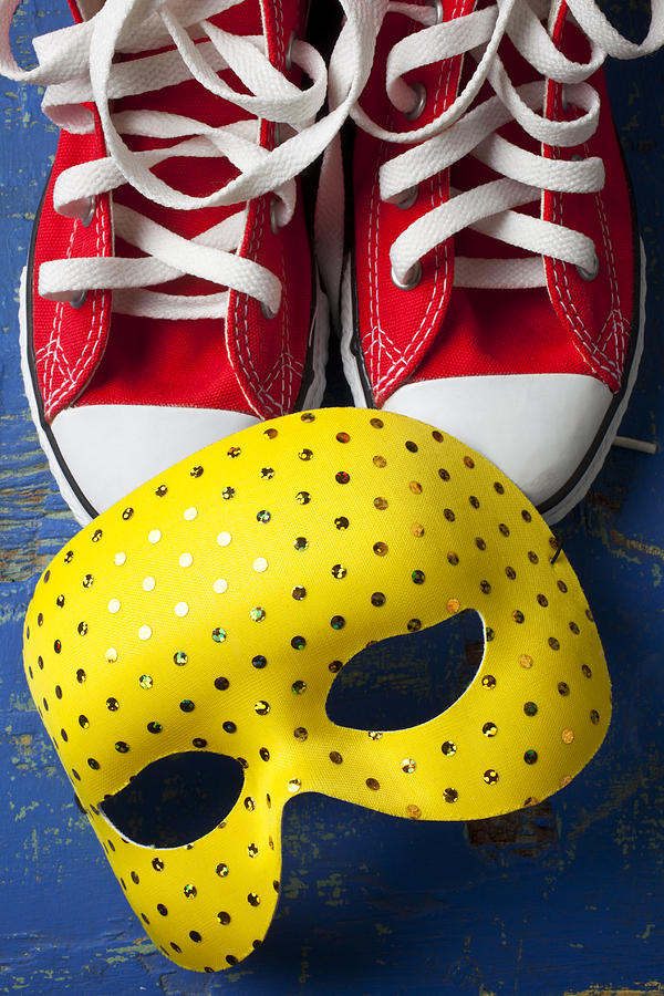 Red Tennis Shoes And Mask Photograph
