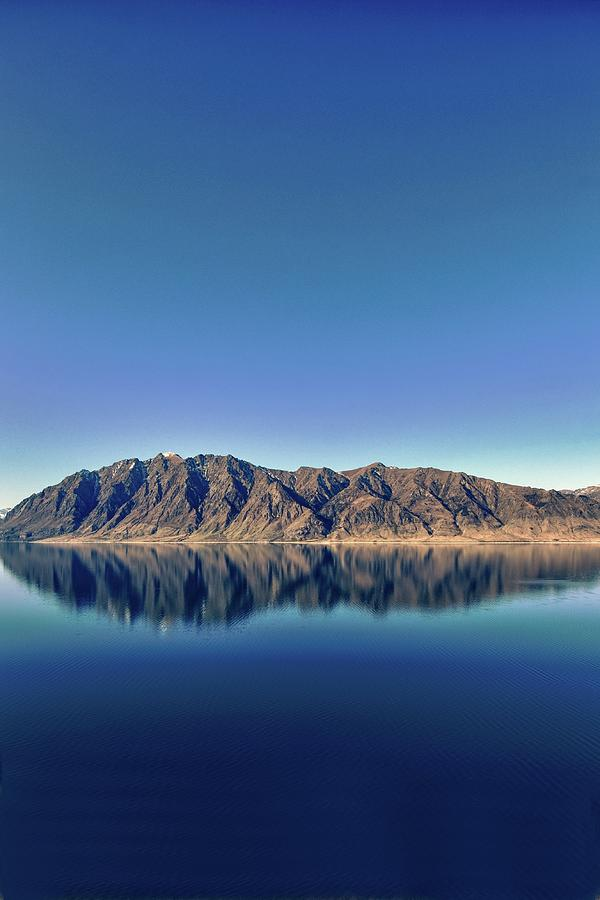 Vertical Photograph - Reflections On Lake Hawea by Verity E. Milligan