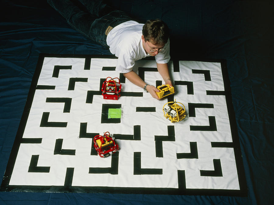Researcher Testing Lego Robots Playing Pacman Photograph  - Researcher Testing Lego Robots Playing Pacman Fine Art Print