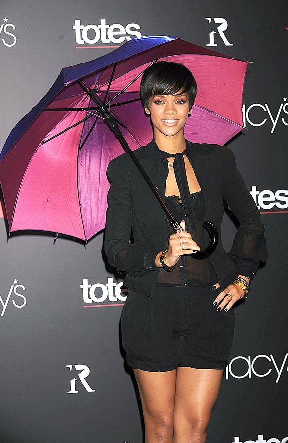 Rihanna Umbrella Collection Launch By Totes And Macy''s Photograph - Rihanna Wearing Matthew Williamson by Everett