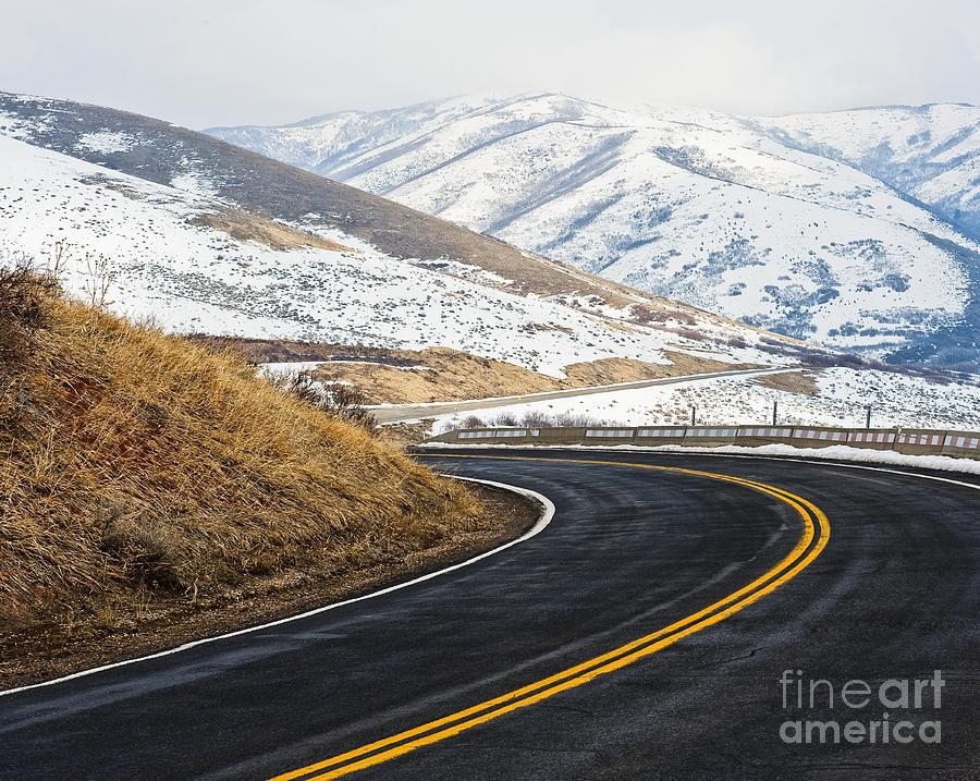 Road Through A Snowy Mountain Landscape Photograph
