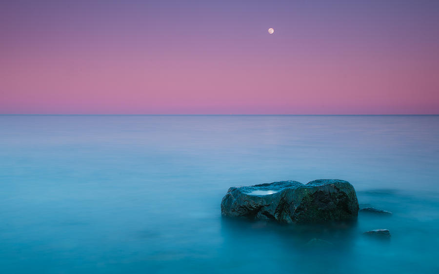 Rock At Coast With Rising Moon Photograph
