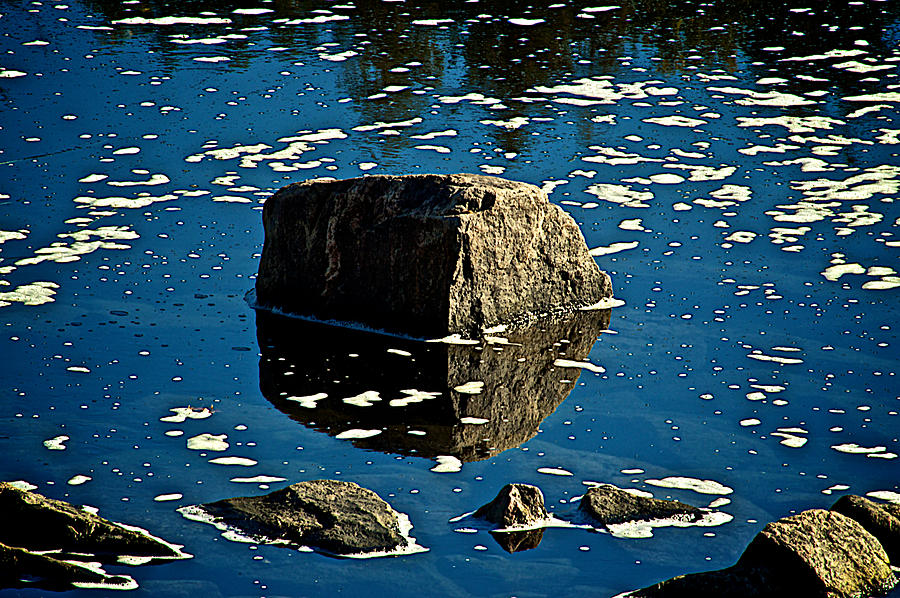 Rock Reflection In Blue Water Photograph