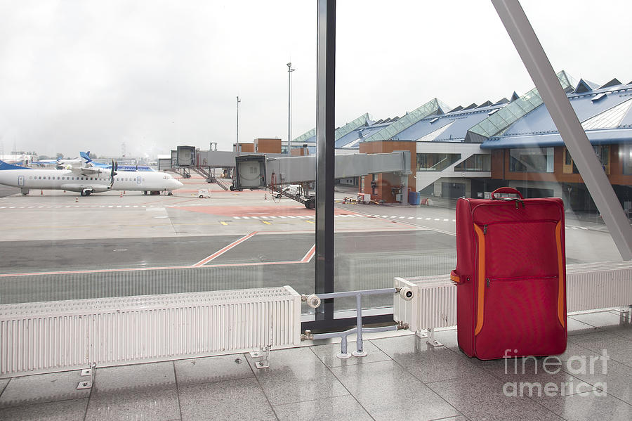 Rolling Luggage In An Airport Concourse Photograph  - Rolling Luggage In An Airport Concourse Fine Art Print