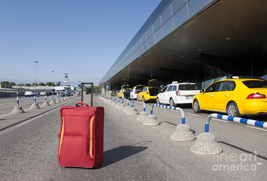 Rolling Luggage Outside An Airport Terminal Photograph  - Rolling Luggage Outside An Airport Terminal Fine Art Print