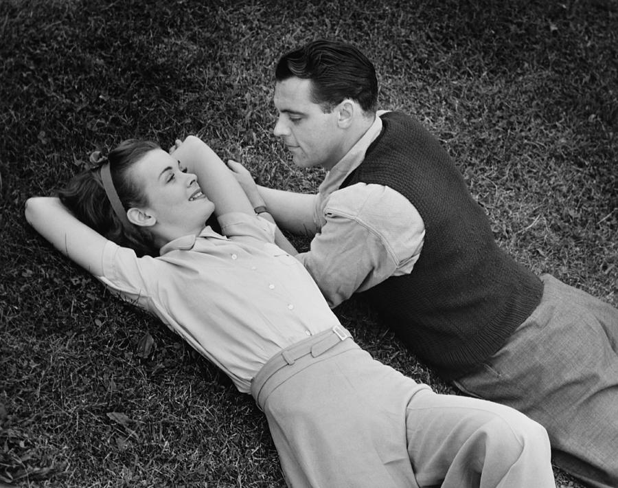 Romantic Couple Lying On Grass, (b&w), Elevated View Photograph