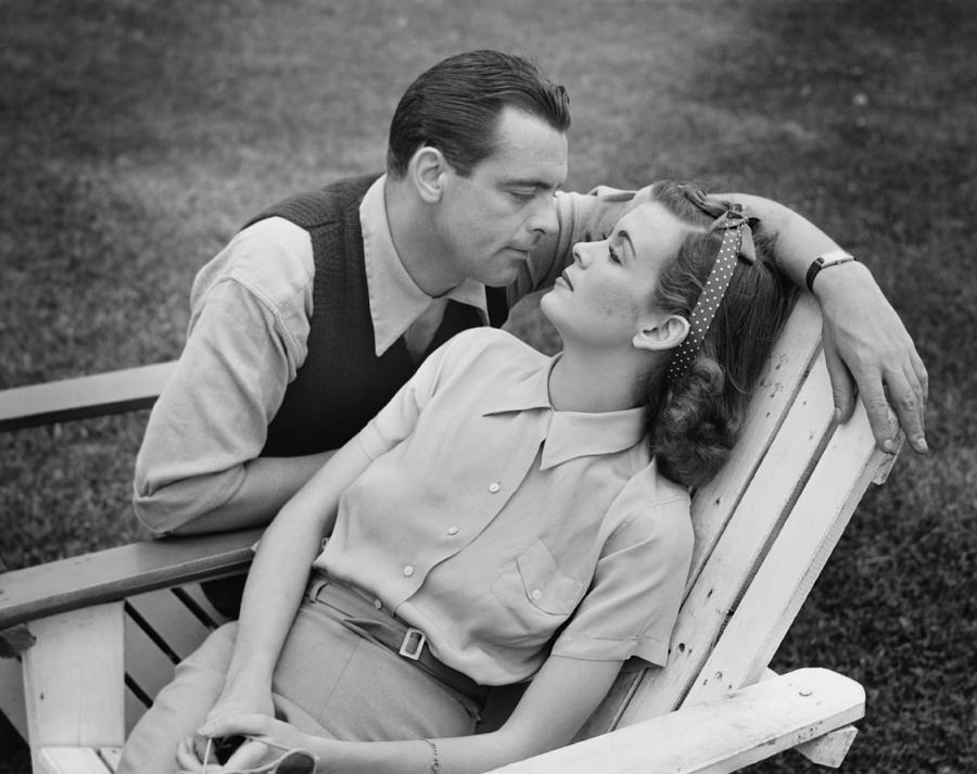 Romantic Couple Relaxing On Deckchair, (b&w) Photograph