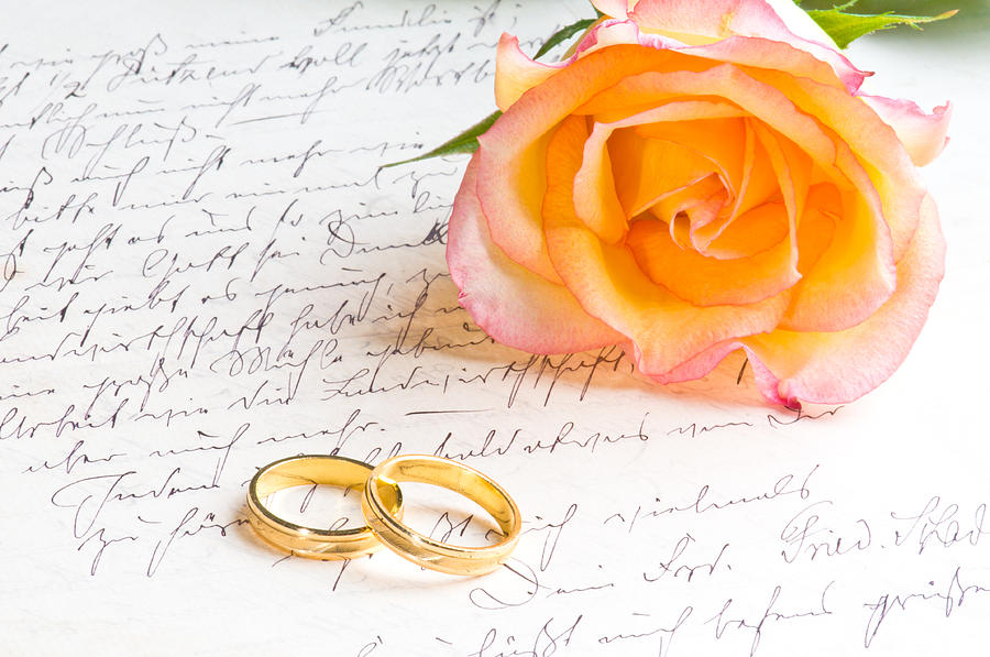 Rose And Two Rings Over Handwritten Letter Photograph