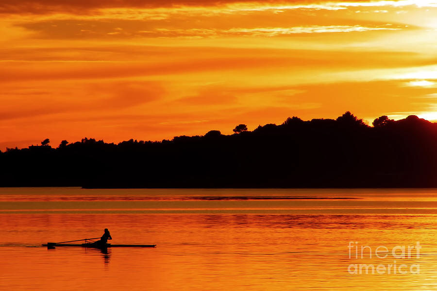 Rowing at sunset is a photograph by nino rasic which was uploaded on
