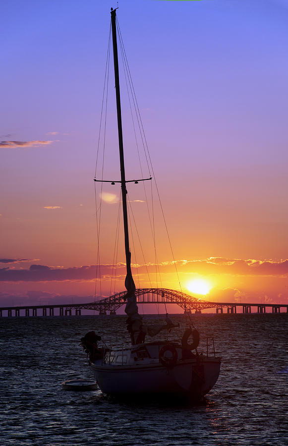 Sailboat And The Bridge At Sunrise Photograph