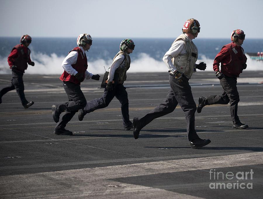 Sailors Clear The Landing Area Photograph
