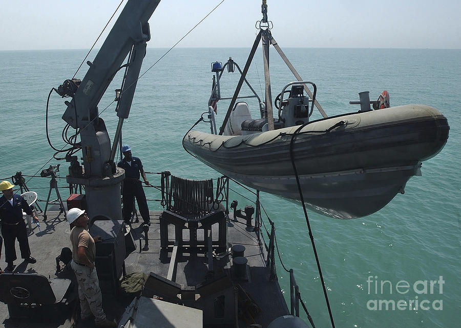 Sailors Lower A Rigid Hull Inflatable Photograph