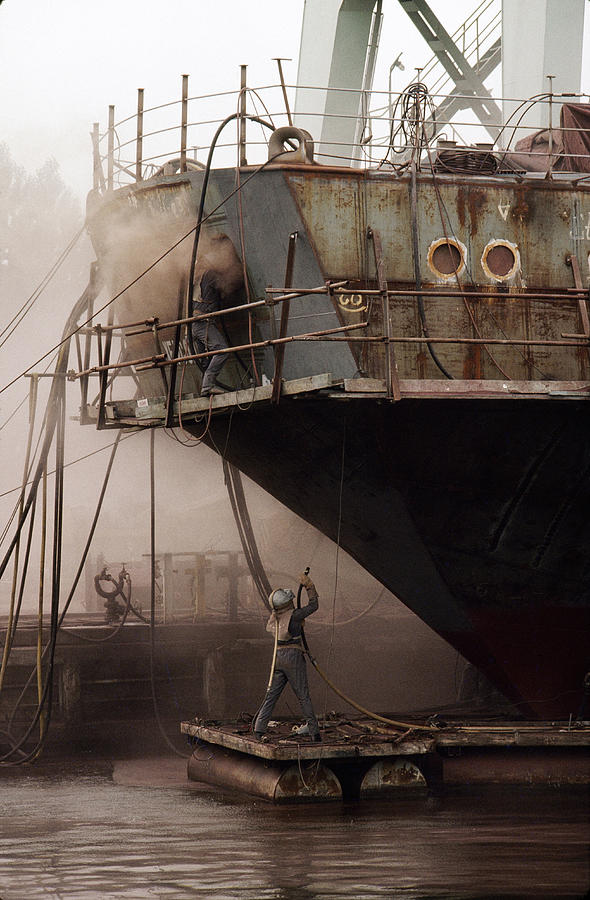 Sandblasters Restore A Soviet Ship Photograph by Cotton Coulson