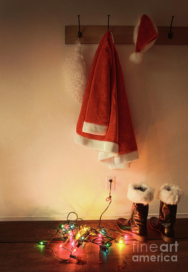 Santa Costume Hanging On Coat Hook With Christmas Lights Photograph  - Santa Costume Hanging On Coat Hook With Christmas Lights Fine Art Print