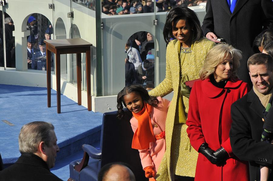 Sasha Obama Peeks Around Her Mother Photograph  - Sasha Obama Peeks Around Her Mother Fine Art Print