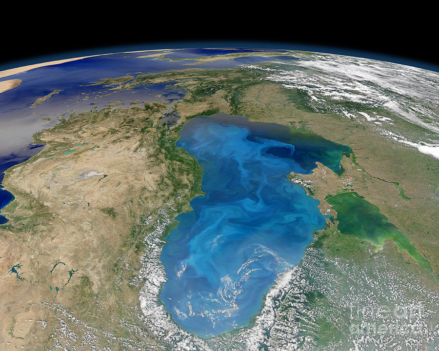 Satellite View Of Swirling Blue Photograph