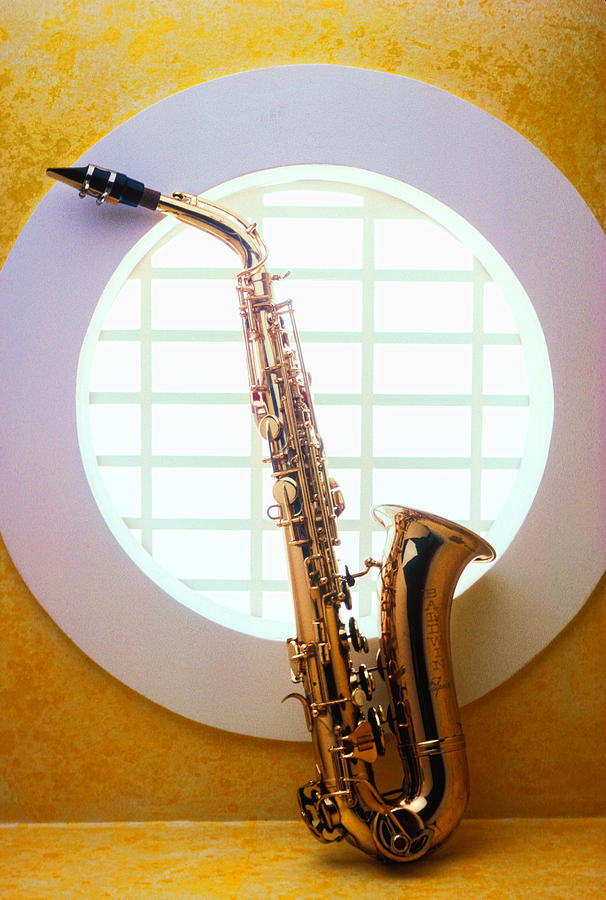 Saxophone In Round Window Photograph