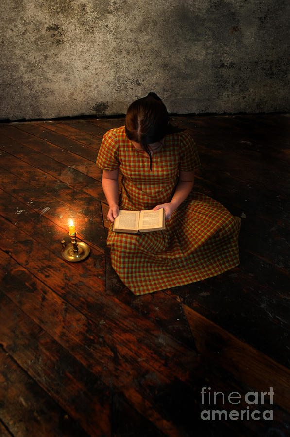Schoolgirl Sitting On Wood Floor Reading By Candlelight Photograph  - Schoolgirl Sitting On Wood Floor Reading By Candlelight Fine Art Print