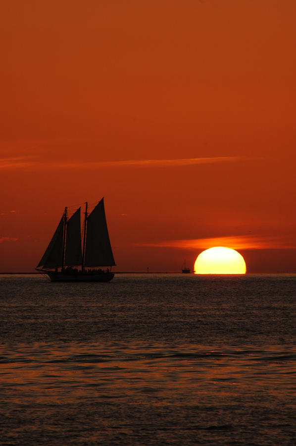 Schooner In Red Sunset Photograph