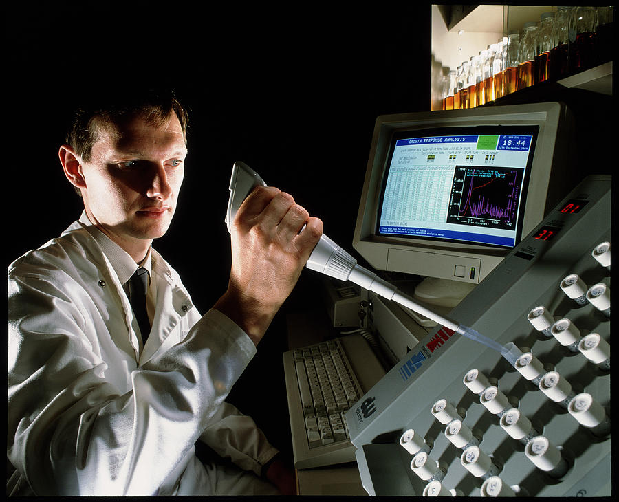 Scientist Using An Automatic Culture Counter Photograph