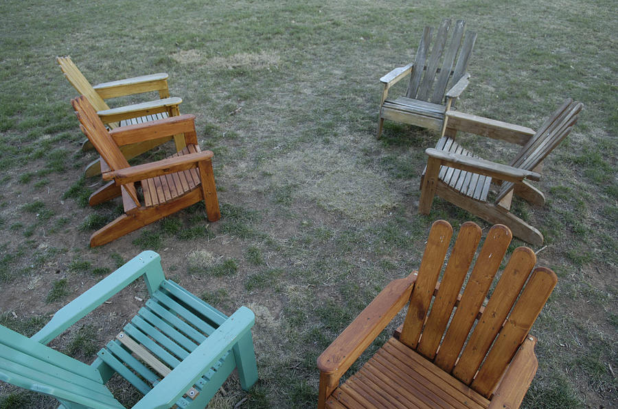 Several Lawn Chairs Scattered Photograph