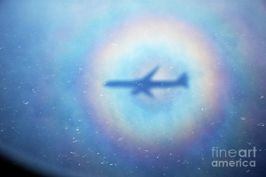 Shadow Of An Aeroplane Surrounded By A Rainbow Halo Photograph