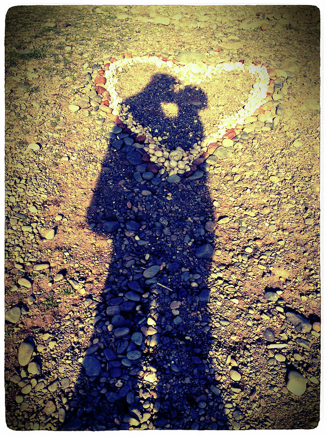 Shadows Of Couple Kissing Over Heart Of Stones Photograph