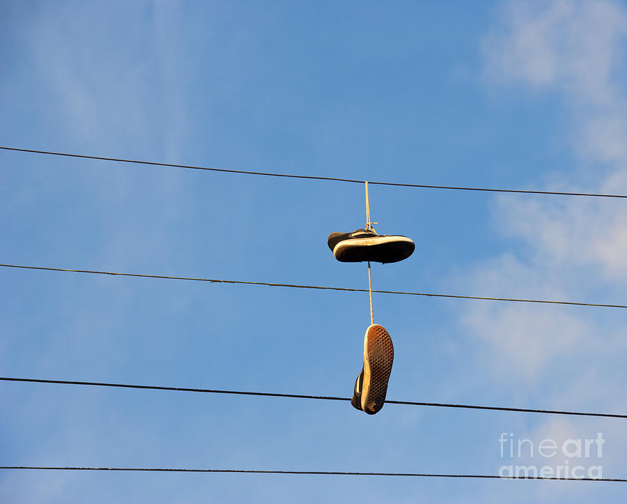 Shoes Hanging From Power Line Photograph
