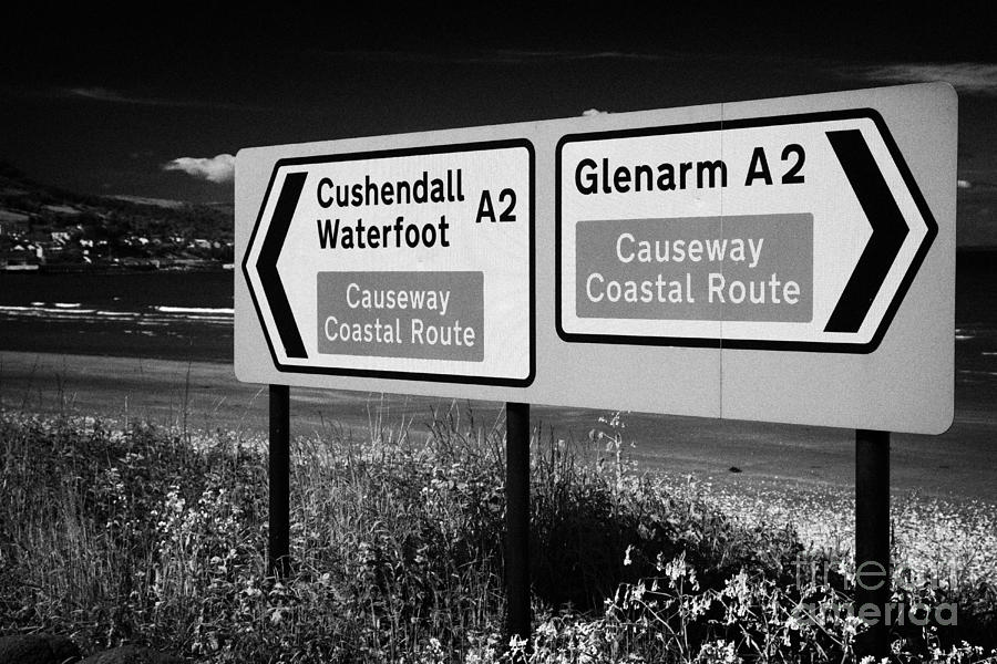 Signposts For The Causeway Coastal Route At Carnlough Between Cushendall And Glenarm County Antrim Photograph  - Signposts For The Causeway Coastal Route At Carnlough Between Cushendall And Glenarm County Antrim Fine Art Print