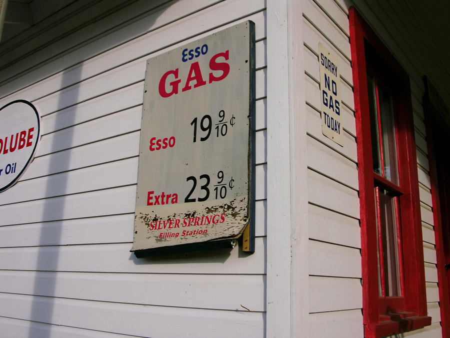 Signs On A Historic Gas Station Offer Photograph