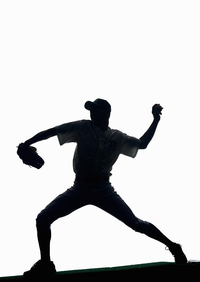 Silhouette Of Baseball Pitcher About To Pitch Photograph