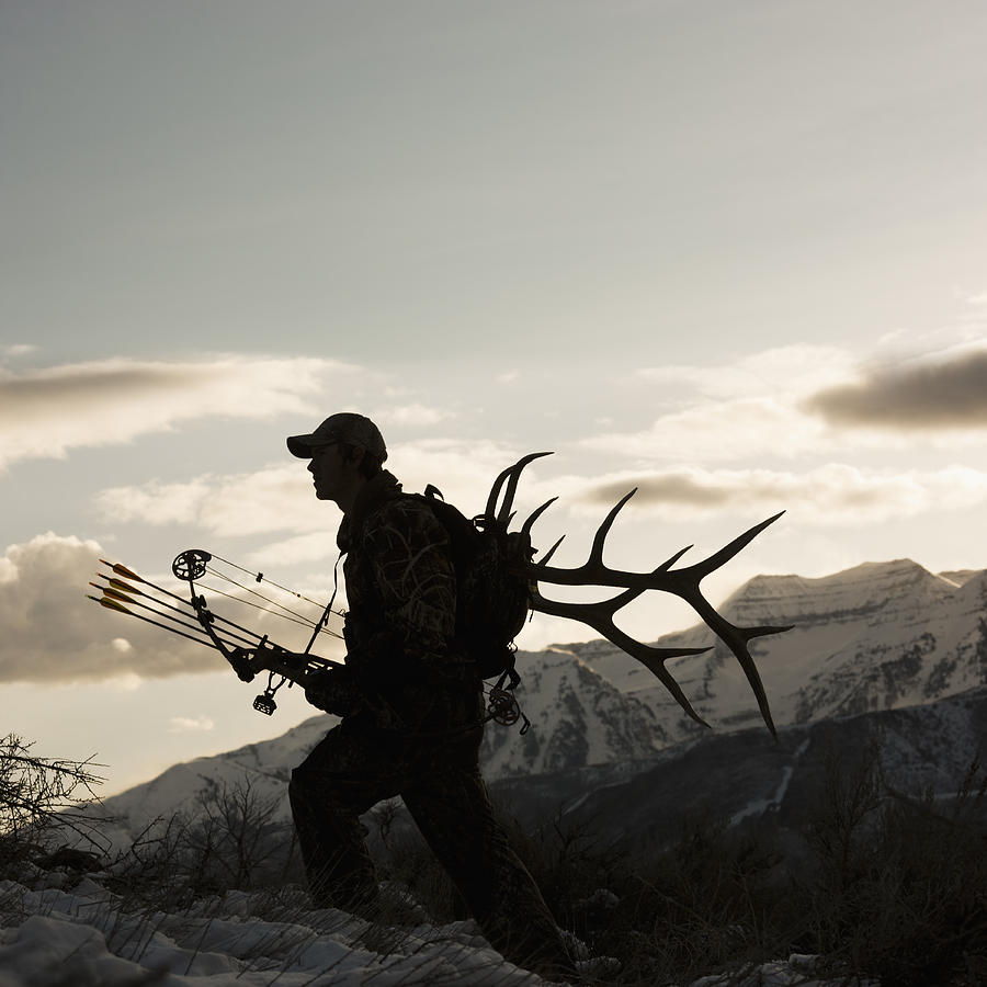 Silhouette Of Hunter Hiking With Elk Antlers Photograph  - Silhouette Of Hunter Hiking With Elk Antlers Fine Art Print