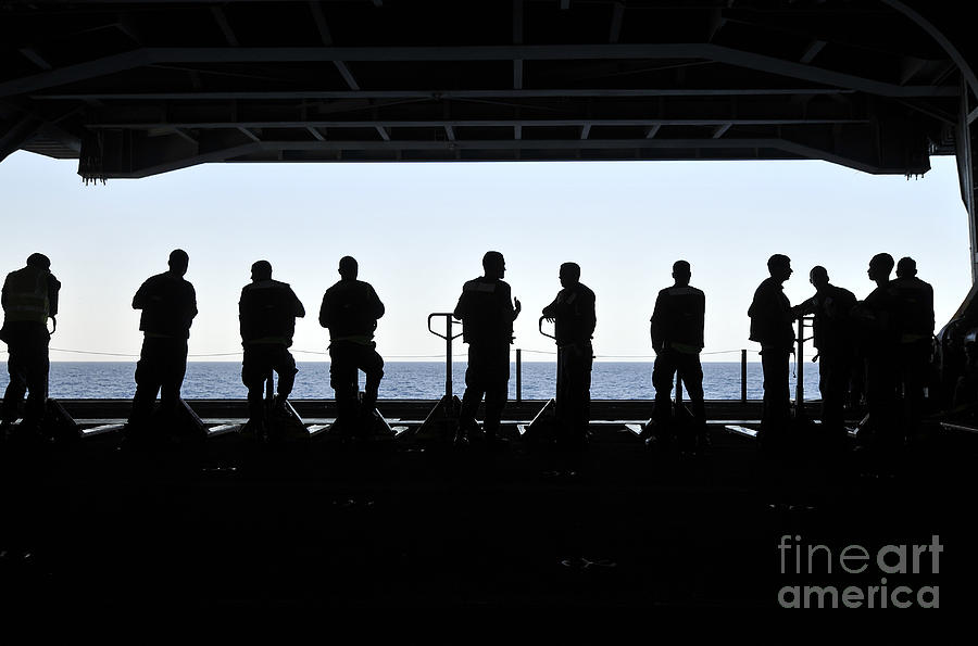 Silhouette Of Sailors Standing Photograph by Stocktrek Images
