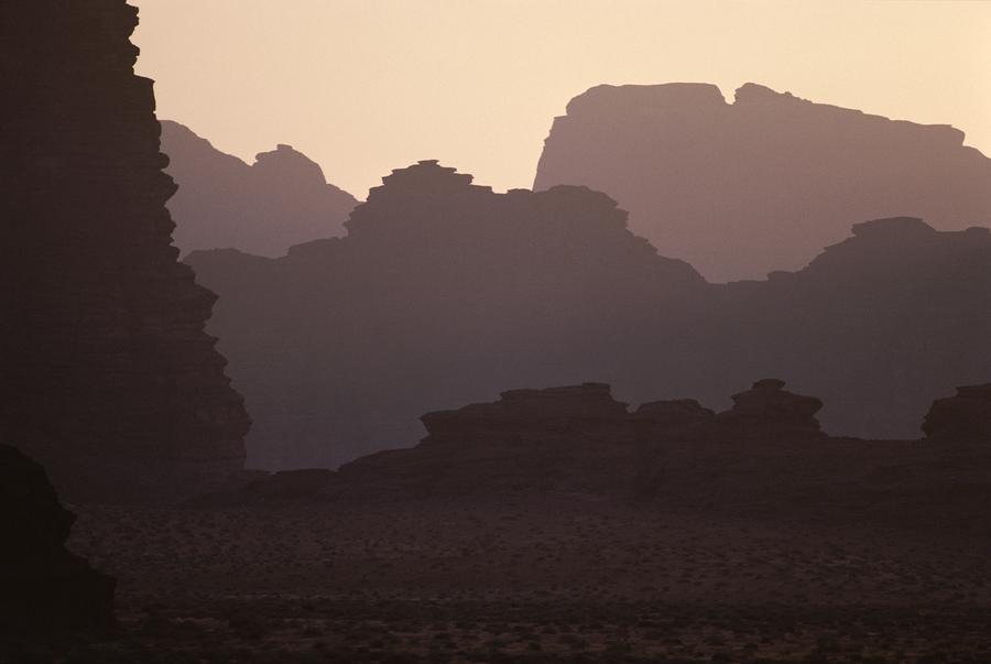 Silhouetted Cliffs In The Wadi Ramm Photograph