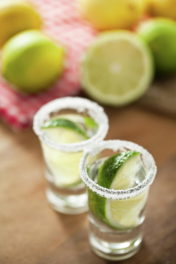 Silver Tequila, Limes And Salt Photograph