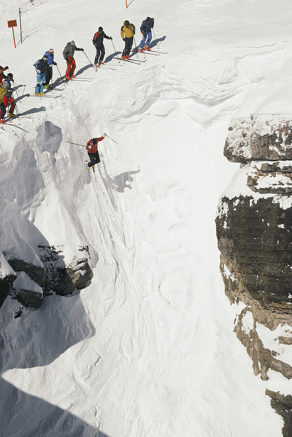 Skilled Skiers Plunge More Than 15 Feet Photograph