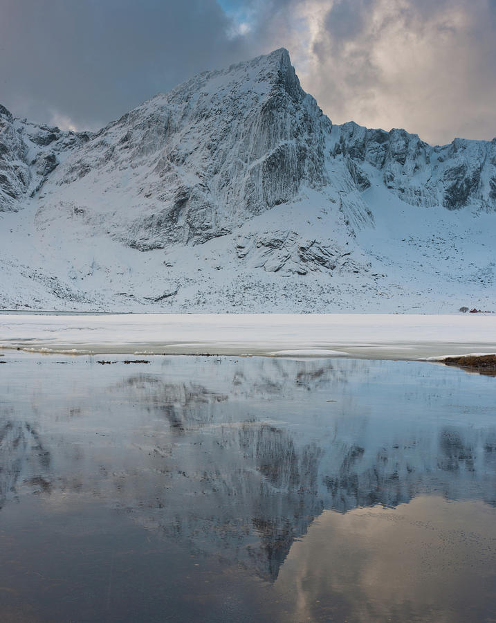 Snow Covered Mountain Reflected In Lake Photograph
